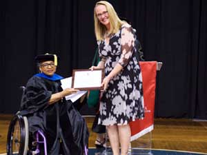 Dr. Amy Eichfeld receiving the Tow Award. Photo courtesy of USD Sanford School of Medicine.