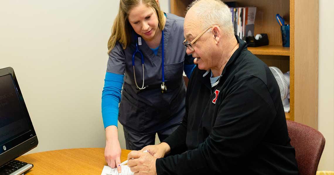 Registered nurse helping medicare patient.
